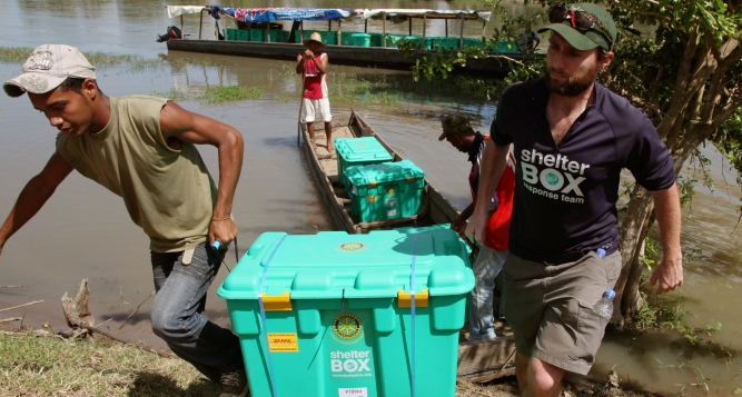 Volunteers deliver ShelterBox to the Philippines.
